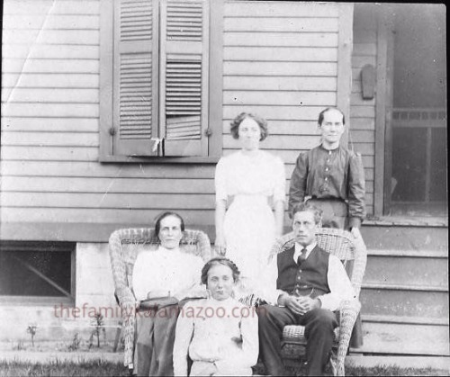 Cora and Adrian in chairs. Standing are Cora's stepsister Marian Sootsman and sister Jennie DeKorn Leeuwenhoek. Seated in front is Jennie's daughter Alice.